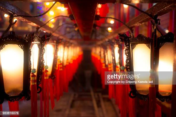 chinese style lanterns in a row at man mo temple, hong kong. - place of worship stock pictures, royalty-free photos & images
