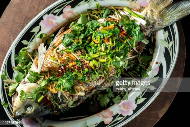 chinese style steamed fish - steamed stock pictures, royalty-free photos & images