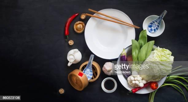 Chinese style vegan food on black background.