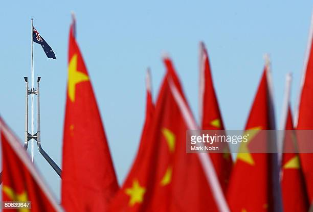 Chinese supporters hold flags at the start of the Olympic Torch relay at Reconciliation Place on April 24 2008 in Canberra Australia The relay route...