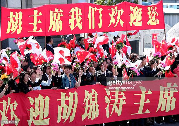 Chinese supporters wave to Chinese president Hu Jintao as he arrives at Tokyo International Airport on May 6, 2008 in Tokyo, Japan. Hu is on a 5-day...