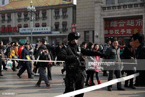 Chinese SWAT stand on duty at Beijing Railway Station on March 2 2014 in Beijing China Beijing strengthens security measures following a stabbing...