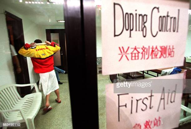 A Chinese swimmer makes her way into an antidoping testing room during the Beijingleg of the FINA Swimming World Cup 25 February Various Chinese...