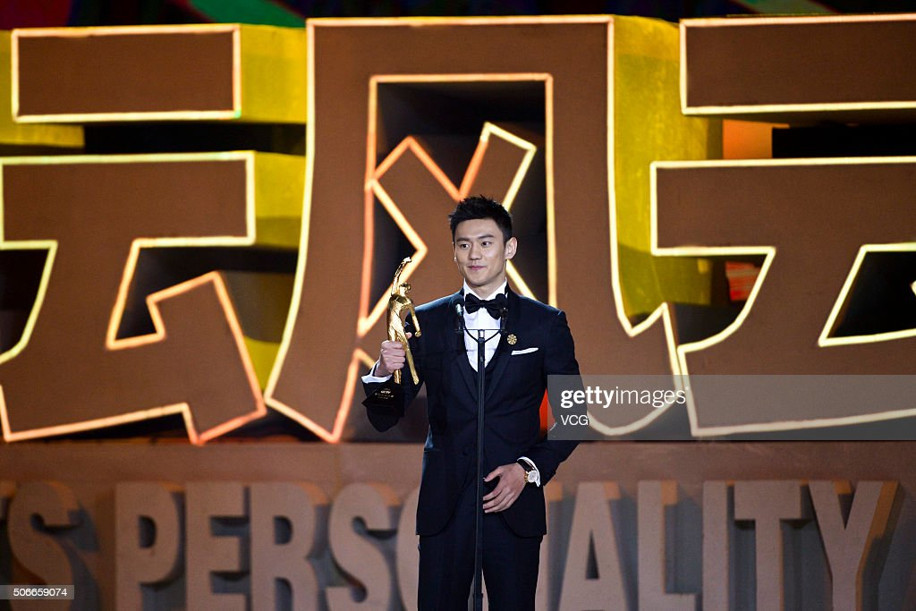 Chinese swimmer Ning Zetao poses with the trophy during the Sports Personality of the Year 2015 on January 24, 2016 in Beijing, China.