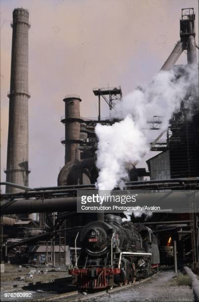 A Chinese SY Clan industrial Mikado waits to draw a rake of Cauldron wagons containing molten steel from the blast furnaces at Anshan Iron Steel...