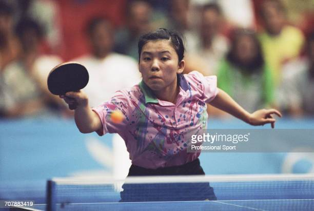 Chinese table tennis player Deng Yaping competes for China to win the gold medal in the Women's singles table tennis event at the 1992 Summer...