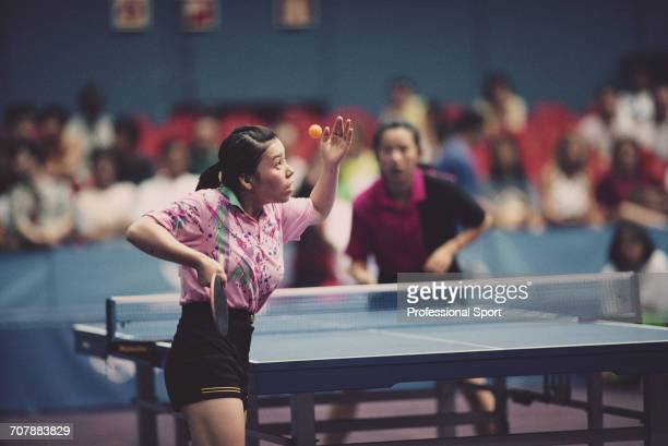 Chinese table tennis player Deng Yaping serves during the gold medal match against fellow Chinese table tennis player Qiao Hong to win the gold...