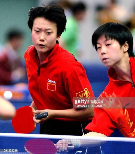 Chinese table tennis players Zhang Yining and Li Nan returns the ball 07 october 2002 during their semifinal match against South Korea's pair Ryu Ji...