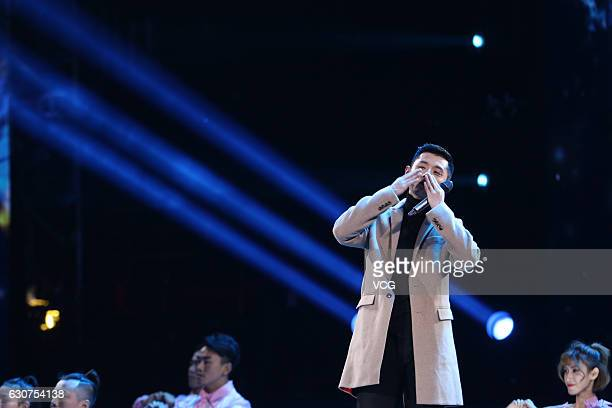 Chinese table tennis star Zhang Jike performs onstage during the new year countdown part held by Shanghai Dragon TV on December 31 2016 in Shanghai...