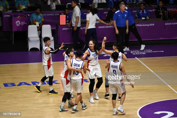 Chinese Taipei players celebrate victory after beating Corea during the Women's Basketball Preliminary round between Unified Corea and Chinese Taipei...
