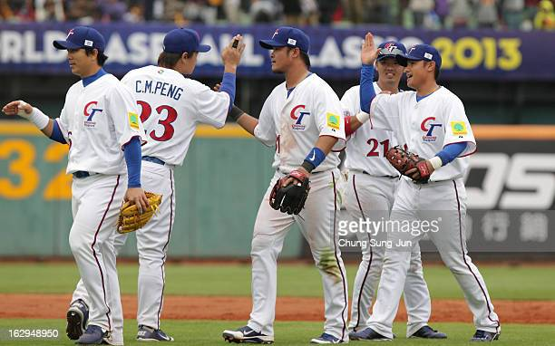 Chinese Taipei team players celebrate after winning against Australia during the World Baseball Classic First Round Group B match between Australia...