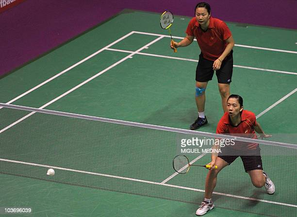 Chinese Taipei's Wen Hsing Cheng and Yu Chin Chien return a shuttlecock to China's Jing Du and Yang Yu during the women's double semifinals of the...