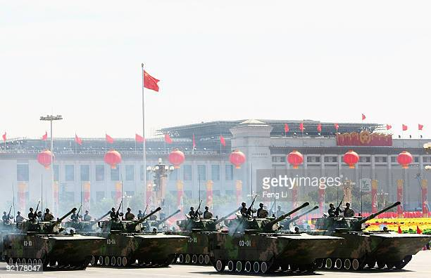 Chinese tanks rumble pass Tiananmen Square during a massive parade to celebrate the 60th anniversary of the founding of the People's Republic of...
