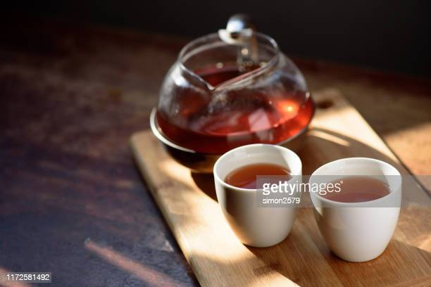 chinese tea cups and tea pot set - black tea stock pictures, royalty-free photos & images