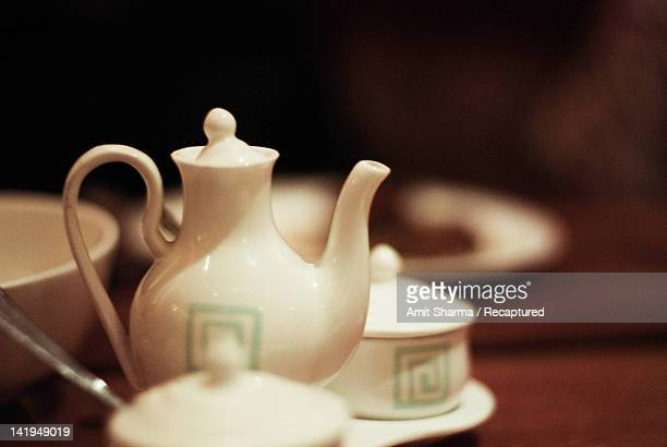 Chinese tea pot along with pots for sauces