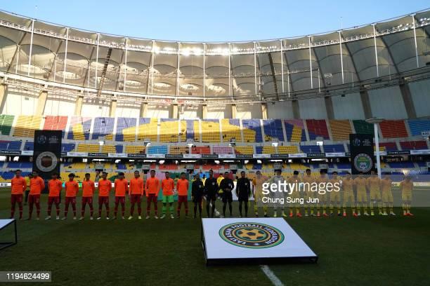 Chinese team and Hong Kong team line up during the EAFF E-1 Football Championship match between Hong Kong and China at Busan Asiad Main Stadium on...