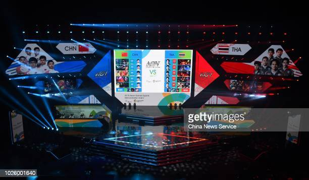 Chinese team and Thai team compete during a match of Esports Demonstration Event 'Arena of Valor' on day eight of the Asian Games on August 26, 2018...