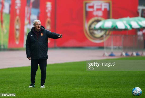 Chinese team manager Marcello Lippi attends a training session before the 2018 FIFA World Cup Qualifiers match against South Korea on March 21 2017...