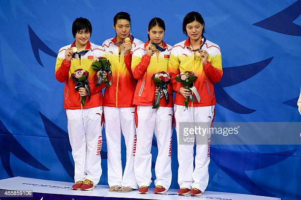 Chinese team wins gold medal in the final of Women's 4 x100m Freestyle during day two of the 2014 Asian Games at Munhak Park Tae-hwan Aquatics Center...