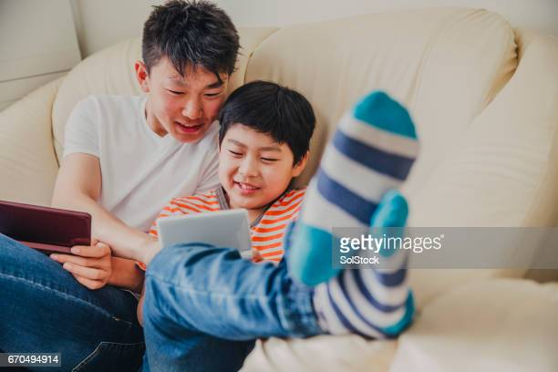 Chinese Teen Brothers Playing Games