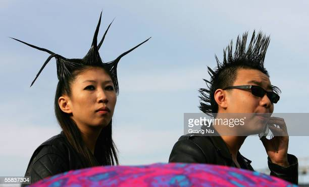 Chinese teenager attend a rockandroll festival to mark Chinese National Day on October 2 2005 in Beijing China Various activities are being held in...