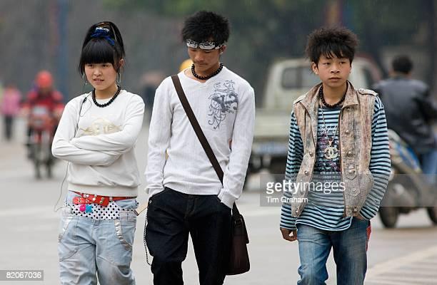 Chinese teenagers walk down a street in Yangshuo China