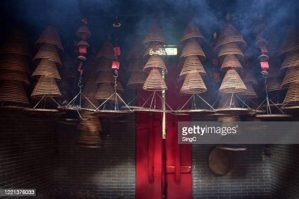 chinese temple incense coil - incense coils stock pictures, royalty-free photos & images