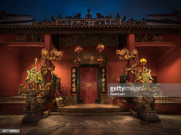 Chinese temple with the mythical guardians statues at the entrance