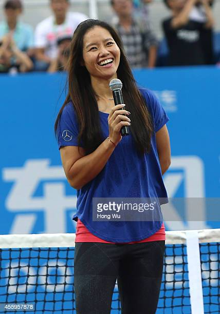 Chinese tennis player Li Na attends her retirement ceremony during day three of the 2014 Dongfeng Motor Wuhan Open at Wuhan Optics Valley...