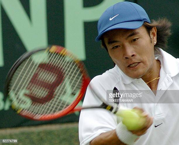 Chinese tennis player Sun Peng plays a return to his unseen Indian opponent Harsh Mankad at the Davis Cup Asia Oceania first round match between...