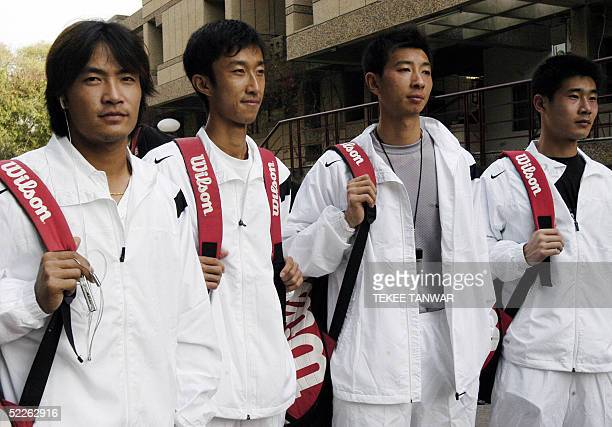 Chinese tennis players , Sun Peng ,Wang Yu, Zhu Ben- Qiang and Lu Hao, pose for photographers as they leave a press conference in New Delhi, 02 March...