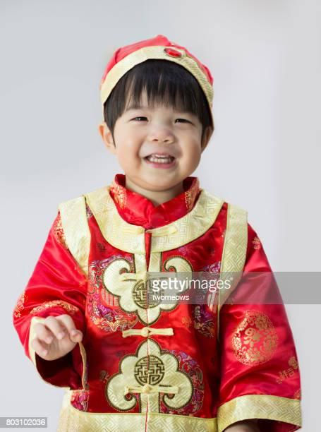 Chinese toddler boy in Cheongsam.