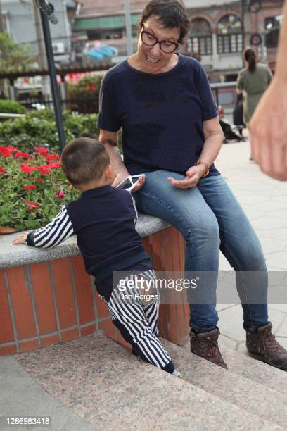 A Chinese toddler with an opening in the back of his pants which is typical in China it is there so the pants can stay on when the toddler goes to...