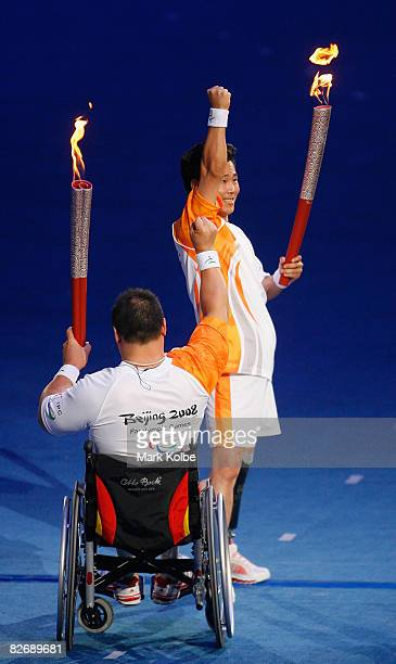 Chinese torchbearer Sun Changting punches the air as he celebrates carrying the Paralympic flame during the Opening Ceremony for the 2008 Paralympic...