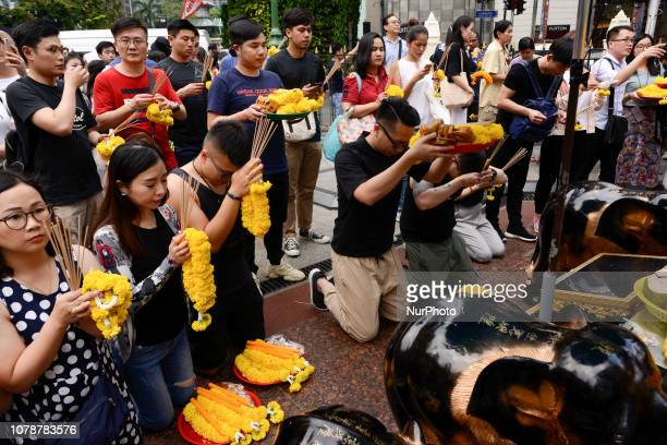 Chinese tourism devotees worship Lord Brahma, the Hindu God of creation, at the Erawan Shrine in Bangkok, Thailand, 7 January 2019.