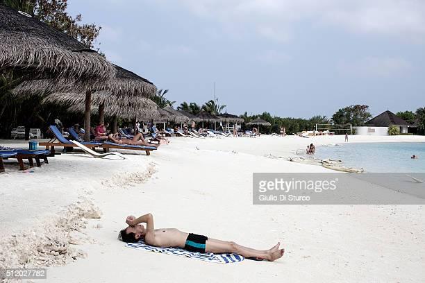 Chinese tourist takes a sunbathe at the beach on January 27 2016 at Centara Ras fushi Resort and Spa Maldives China's top diplomats estimates around...