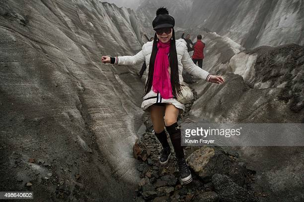 Chinese tourist walks in the tongue of Glacier 1 at the base of the 7556 m Mount Gongga known in Tibetan as Minya Konka on November 10 2015 in...