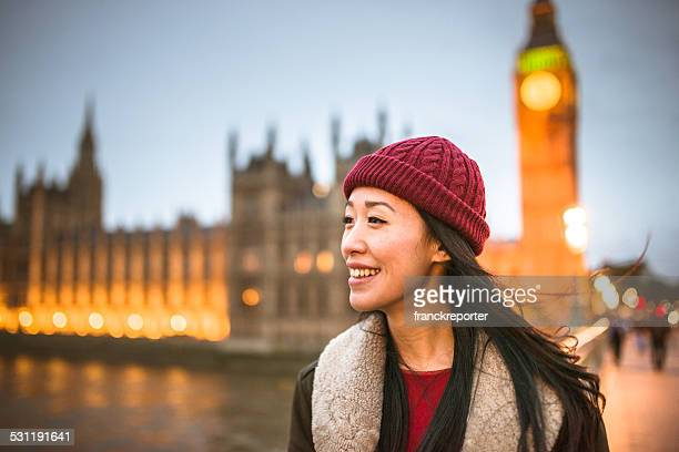 chinese tourist woman walking on the streets of london