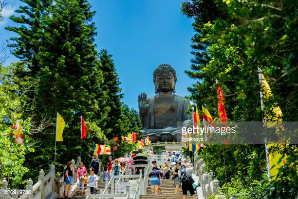 chinese tourists at giant buddha hong kong - buddha stock photos and pictures