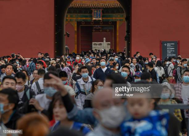 Chinese tourists crowd as they leave the exit of the Forbidden City on October 6, 2020 after tickets sold out during the 'Golden Week' holiday in...