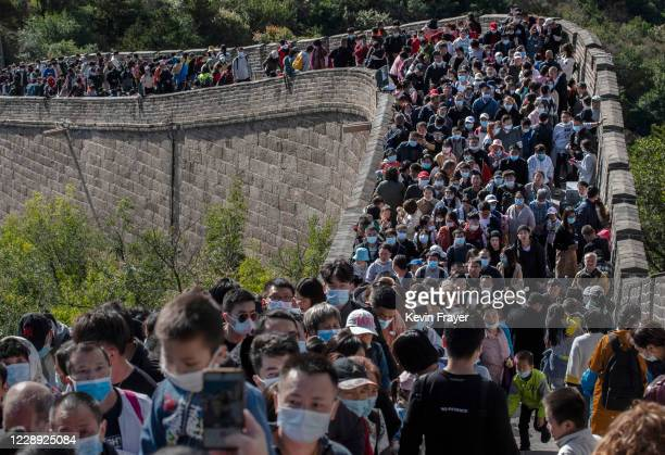 Chinese tourists crowd in a bottleneck as they move slowly on a section of the Great Wall at Badaling after tickets sold out during the 'Golden Week'...