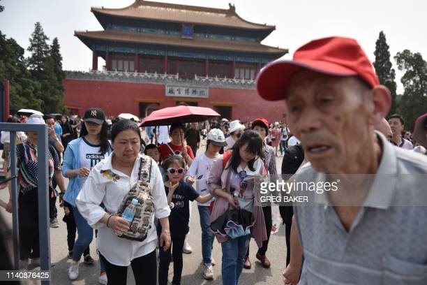 Chinese tourists emerge after a visit to the Forbidden City the former home of China's emperors during a fourday national holiday marking May Day in...
