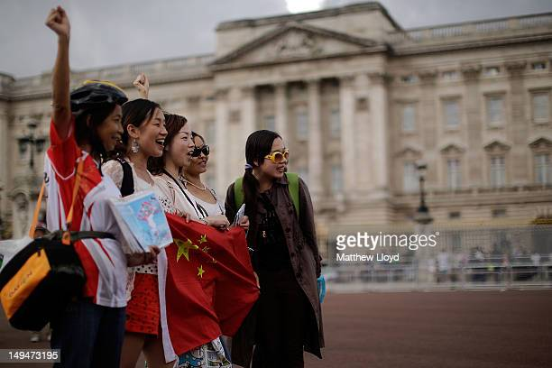 Chinese tourists have their pictures taken outside Buckingham Palace on July 29 2012 in London England Today the womens road race takes over the...