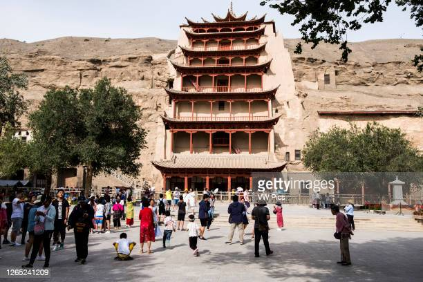 Chinese tourists in front of the Mogao Buddhist caves.