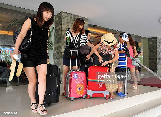 Chinese tourists in Manila leave their hotel on August 24 2010 a day after eight Hong Kong tourists were killed by a gunman in a dramatic bus...