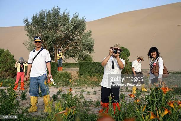 Chinese tourists in the Gobi desert.