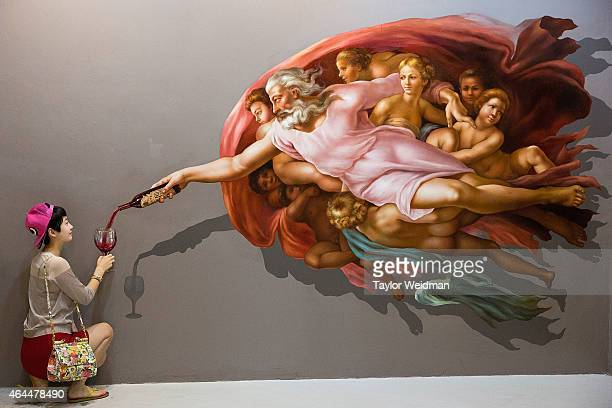 Chinese tourists pose for pictures at Art in Paradise an illusion art museum popular amongst tourists on February 26 2015 in Chiang Mai Thailand Due...