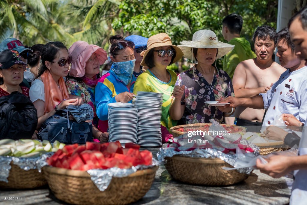 Chinese tourists queue up for fruit buffet in Hon Tam Resort on September 10, 2017 in Nha Trang, Vietnam. With a total of 2.7 million tourists in 2016, China is Vietnam's largest source of visitors, as most mainland Chinese head to the coastal cities of Da Nang or Nha Trang located in the centre of the country and famed for their beaches, historical sights and seafood. Based on reports, Chinese tour groups have grown to 150 to 200 while the influx has caused problems such as the lack of Chinese speaking staff and inexperience in dealing with inappropriate behavior by the mainland Chinese who have been criticized for their lack of manners in public spaces, including spitting and urinating in public and being noisy at religious places and heritage sites. As Vietnamese travel agencies aim to improve service for Chinese tourists, local media have reported the illegal use of the Renminbi in local markets and Chinese agents and guides acting without proper authorization, leading to distortions in how Vietnam's history and culture have been presented.