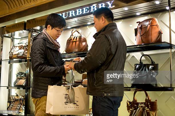 Chinese tourists shop at Harrods department store in London on December 10 2012 two weeks ahead of Christmas With their shelves spilling over with...