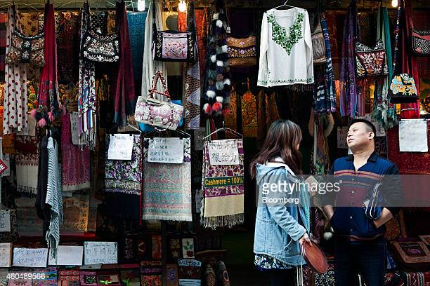 Chinese tourists stand outside a store in the Thamel area of Kathmandu Nepal on Thursday Dec 4 2014 China this year overtook India as Nepals biggest...